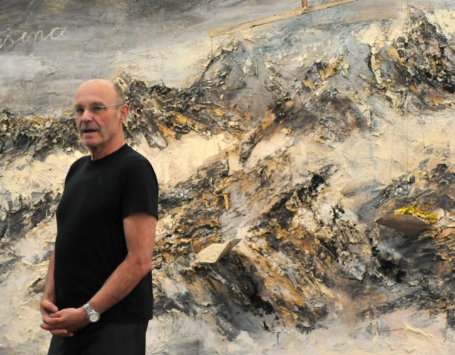 "German painter and sculptor Anselm Kiefer poses in front of his work ""Essence"" on October 5, 2011 at the Museum Frieder Burda in Baden-Baden, southern Germany. From October 7, 2011 to January 15, 2012, the museum presents the exhibition ""Anselm Kiefer. Selected Works from the Collection Grothe"", which will feature 33 large-format paintings from thirty years with a focus on the last decade. AFP PHOTO ROLF HAID GERMANY OUT (Photo credit should read ROLF HAID/AFP/Getty Images)"