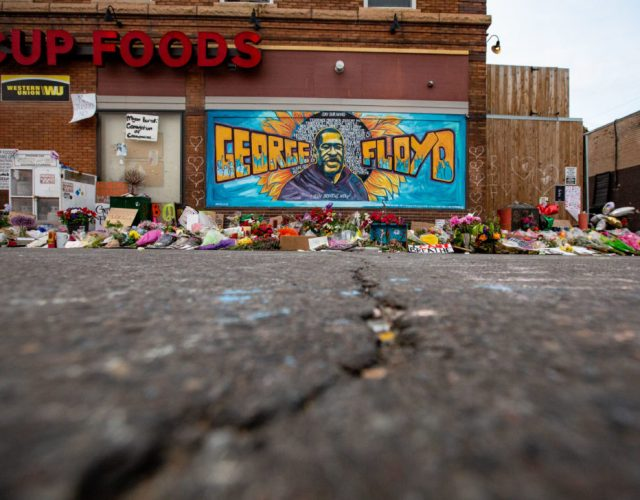 MINNEAPOLIS , MINNESOTA - MAY 31: The mural and makeshift memorial outside Cup Foods where George Floyd was murdered by a Minneapolis police officer on Sunday, May 31, 2020 in Minneapolis , Minnesota. (Jason Armond / Los Angeles Times via Getty Images)