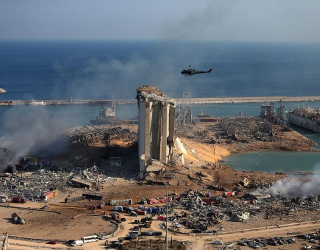 A general view shows the damaged grain silos of Beirut's harbour and its surroundings on August 5, 2020, one day after a powerful twin explosion tore through Lebanon's capital, resulting from the ignition of a huge depot of ammonium nitrate at the city's main port. - Rescuers searched for survivors in Beirut after a cataclysmic explosion at the port sowed devastation across entire neighbourhoods, killing more than 100 people, wounding thousands and plunging Lebanon deeper into crisis. The blast, which appeared to have been caused by a fire igniting 2,750 tonnes of ammonium nitrate left unsecured in a warehouse, was felt as far away as Cyprus, some 150 miles (240 kilometres) to the northwest. (Photo by STR / AFP) (Photo by STR/AFP via Getty Images)