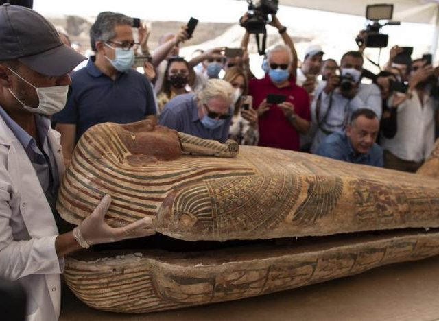 a_member_of_egyptian_archaeological_team_opens_the_sarcophagus_is_around_2500_years_old_at_the_saqqara_archaeological_site_30_kilometers_south_of_cairo_egypt_saturday_oct._3_2020._ap
